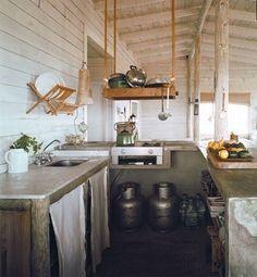 Neat hanging pot shelf!   Also, mounted dish drying rack