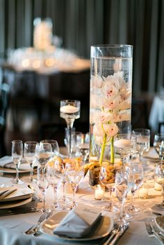 Featured Photographer: Sarah Tew Photography; Elegant wedding centerpiece idea
