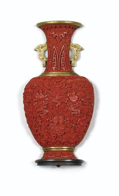 RARE GOLD BRONZE VASE WALL AND CARVED RED LACQUER QING DYNASTY, QIANLONG PERIOD   baluster shape with flat back, belly bulging carved Eight Buddhist Emblems on cloud background, the flared neck flanked by coves, small accidents; wooden base  17.8 cm, in 7.
