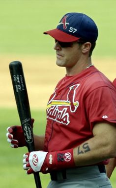 St. Louis Cardinals catcher Mike Matheny wears the number of Darryl Kile (57) on his arm and cap at Wrigley Field in Chicago, Sunday, June 23, 2002. Kile died before Saturday's game, which was postponed, and today's game is being played in his honor. (AP Photo/Brian Kersey)