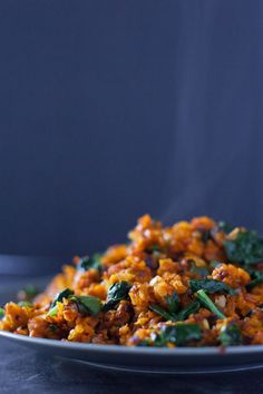 This colorful paleo sweet potato hash recipe has just four ingredients, and packs a nutritional punch that makes it a fantastic side dish for breakfast, lunch, or dinner. Great paleo and vegan recipe! From http://EatingRichly.com