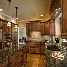 I've been looking for a back splash that will look good with our kitchen Uba Tuba granite & Cherry wood cabinets.