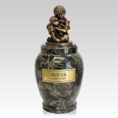 The His Best Doggy Marble Cremation Urn is a beautifully detailed figurine of a little boy with his doggy mounted on a true marble base. The figurine is cast of polymer with a bronze finish. The engraved plaque will make this whimsical memorial truly special.