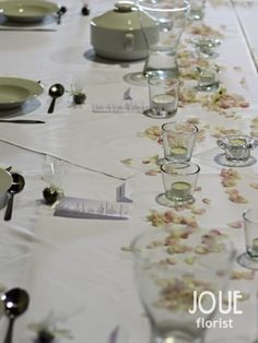 Rustic peony wedding on a farm, table prepared and decorated for a wedding lunch (in detail)