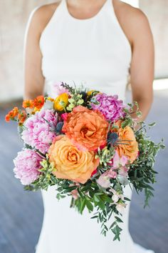orange and pink bouquet - photo by Keira Lemonis Photography http://ruffledblog.com/eclectic-wedding-at-hudson-pocketbook-factory