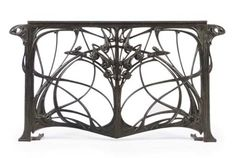 HECTOR GUIMARD (1867-1942)  A PATINATED CAST-IRON BALCONY RAILING, CIRCA 1907-1912