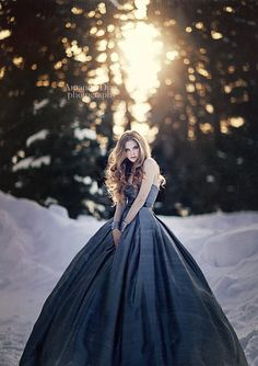 winter or dark snow queen type of photo shoot.  Lovely hair and that gray dress is amazing next to the snow.