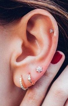 Thinking of getting your next ear piercing? Here are 16 (compelling) reasons why it should definitely be a helix ear piercing. Thinking of getting your next ear piercing? Here are 16 (compelling) reasons why it should definitely be a helix ear piercing. Ear Piercing Guide, Cartilage Piercing Stud, Ear Peircings, Ear Piercings Cartilage, Cartilage Earrings, Stud Earrings, Tongue Piercings, Triple Lobe Piercing, Triple Helix
