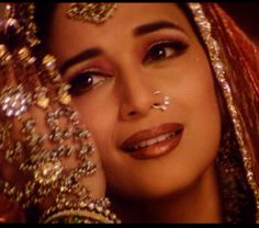 Madhuri Dixit in full courtesan regalia at the end of Devdas. http://www.lisaeldridge.com/video/25895/100-years-of-bollywood-modern-day-devdas-inspired-makeup-look/ #Makeup #Beauty #Bollywood