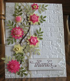 card with white brick embossing plate texture, a trellace and a clover of cure flowers with button centers,,