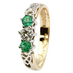 Emerald Celtic Engagement Ring with Trinity Knot Design