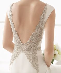 Glamorous low butterfly jeweled back design wedding dress; Featured Dress: Rosa Clara