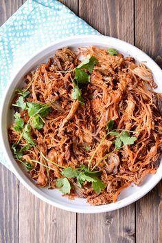 How to make the best slow cooker pulled pork! The perfect homemade spice blend makes it great for sandwiches, tacos and more!!