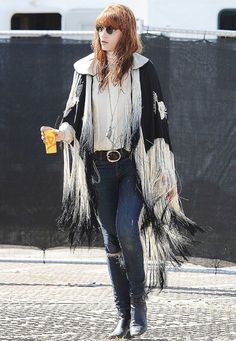 Florence Welch channeling Stevie Nicks in a fringed cape #StreetStyle