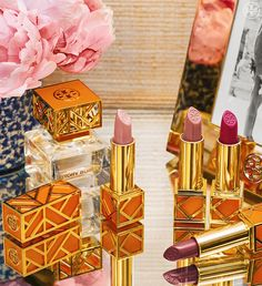 Encased in gold and orange fretwork, the Tory Burch Lip Collection is a super-chic accessory in itself.