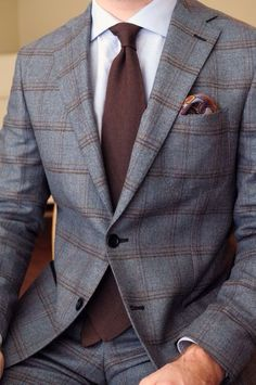 Grey and brown windowpane plaid suit, brown tie, white shirt