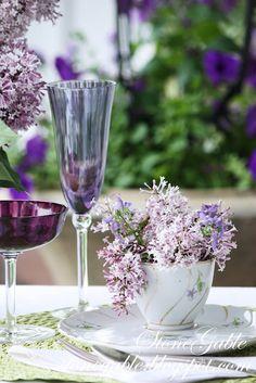 Spring table setting with lilacs. Via Stone Gable.