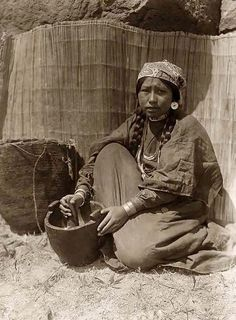 Here for your perusal is a one-of-a-kind photograph of Pounding Fish. It was created in 1910 by Edward S. Curtis.    The photograph illustrates Tlakluit woman seated with mortar and pestle.    We have compiled this collection of photographs mainly to serve as a valuable educational resource. Contact curator@old-picture.com.