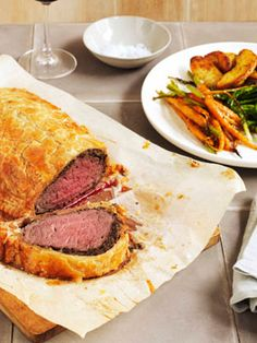 Beef Wellington: http://www.gourmettraveller.com.au/beef-wellington.htm I've made this several times.