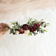 Please note the delivery time is 2,5 - 4 weeks from Russia, making time is business 1-2 days. An elegant floral headpiece featuring burgundy and white artificial flowers with artificial greenery. Length is approximate 7 (17-18 cm) from end to end. Secures in the hair with two small