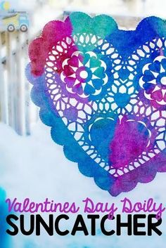 These Valentines Day Doily Suncatchers are beautiful and so fun to make! It's a perfect simple kids activity for Valentines Day! #ValentinesDay #kidscraft #kidsactivity #Valentines #suncatcher #craft #preschool