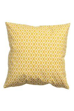 Patterned cushion cover: Cushion cover in a patterned cotton weave with a solid colour back and concealed zip.