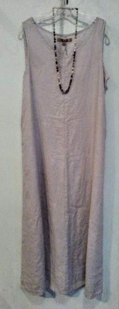 """BEST PRICE! WAS $88    Smokey sleeveless, full-legnth dress with pocketsand scoop neck, the comfort and wearibility makes this dress a stylish choice for your wardrobe.    Add a stone-beaded necklace for more panache! (was $30)    Derived from the latin word meaning """"most useful,"""" the flax plant is a highly sustainable resource with fibers that make durable, soft and very easy-to-wear clothing. Touted for the style and comfort, Flax garments are also known to be long-lasting. Due to the…"""