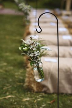 Aisle Wild Flowers on Shepherds Hooks. - Jackson & Co Photography | Outdoor Wedding at West Lexham | Donatelle Godart Wedding Dress | Reiss Suit | Bake Off Dessert Table