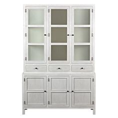 With its rustic chic white wash finish, soft blue interior and antiqued metal details, this hutch brings stylish organization to a rustic kitchen or dining space. Glass panels on the upper compartments let you show off favorite china, while the cubby holes below keep extra dishes or cooking items out of sight until needed. Three drawers providing even a home for table linens. Build a lovely room around this elegant, colonial inspired piece.