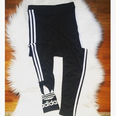 """ADIDAS Black Jogger Pants! Classic black and white jogger pants. Size is medium. It is my sisters and has been worn twice. Also in good condition. Can fit up to a 28"""" with stretch. Any questions, please ask. No trades. It's hard to tell in the pic but the """"ADIDAS"""" is more of an off white when compared to the stripes. Adidas Pants Track Pants & Joggers"""
