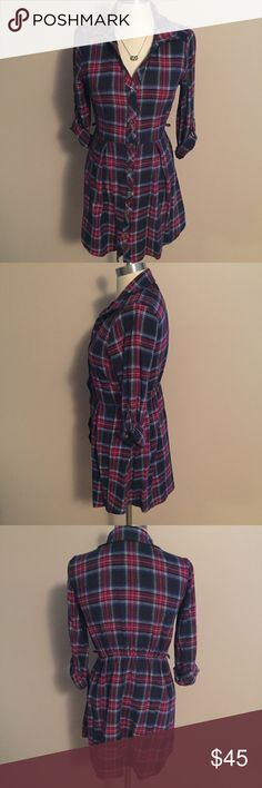 Gorgeous Boutique Flannel Plaid Tunic Dress This is a gorgeous flannel plaid tunic (or dress if you are short like me). It buttons all the way up and there are small loops on each side for a belt (not included). In great condition! Perfect for fall or Christmas parties. Sugarmint Dresses