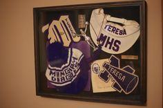 A shadow box creation using items from my mothers cheerleading days.