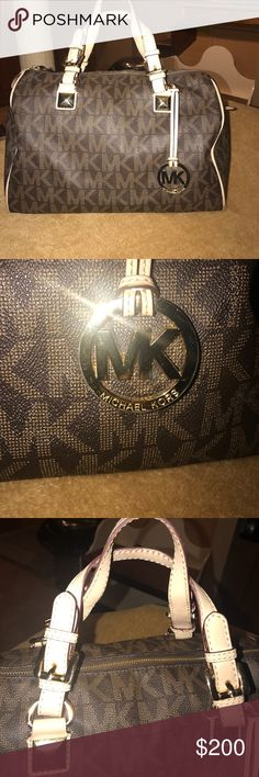 Michael Kors Large Signature HandBag This bag has been worn, the material on the bottom has some tears and needs to be cleaned, there are some scratches on the bag as well and on the inside there is some dust from makeup, but overall the condition is good Michael Kors Bags