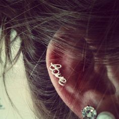 cursive love earring peircings-and-tattoos