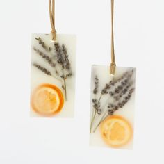 "Pressed Flower Sachets, Lavender  Tangerine ~ ""Tuck these botanical wax sachets into a drawer, or hang in a closet with the attached suede cord, to spread the refreshing scents of tangerine and lavender with notes of bergamot, violet, and purple sage."" ~ Set of 2 ~"