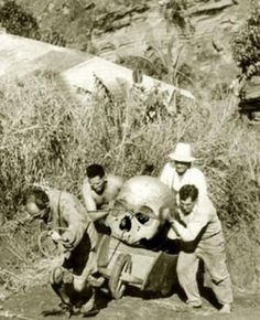 Pitcairn Island, New Zealand - 1934. Local farmers are trying to hide pieces of a giant skeleton found near 'Christians cave'. Three of the men were later found dead under strange circumstances. The forth man disappeared soon after this photo was taken and was never found. The photographers identity has never been revealed.