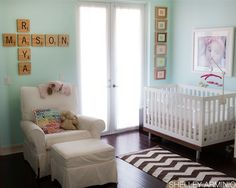 from the scrabble letters to the giant photos, this nursery for twins is absolutely perfect!.