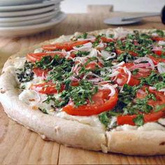 White Pizza - Ricotta, Parmesan, & mozzarella are the three cheeses highlighted in this meatless pizza
