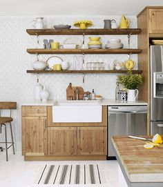 Great wood cabinets, open shelving, and kitchen island. Plus, that farmhouse sink!     #kitchens #decorating