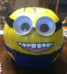 Here's an awesome Halloween decorating idea. Paint a real or fake pumpkin light green and turn it into a cute Minion like this from Despi...
