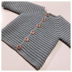 Knit baby cardigan - merino knit baby cardigan - handknit sThe new arrival will look very smart in this knobbly bobbly cardigan, crochet as coming home prezzie, free crochet baby pattern.French Macaroon Baby Sweater Free Knitting Pattern a href='/tag/free Baby Sweater Knitting Pattern, Knitted Baby Cardigan, Hand Knitted Sweaters, Baby Sweaters, Baby Knitting Patterns, Crochet Pattern, Free Pattern, Knitting For Kids, Crochet For Kids