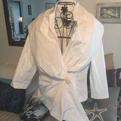 Fabulous dressy top This bright white FULL collared 3/4 length sleeves has a hidden snap closure behind button. Paired with almost any skirt or even a pair of nice jeans, pearls and heels and suddenly you're a movie star! NWOT Sutton Studio Tops