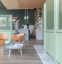 Grzywinski+Pons pairs industrial fixtures with pastel tones for Urban Villa hotel lobby