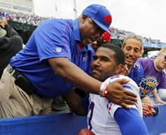 Buffalo Bills quarterback EJ Manuel, right, gets a hug from his father, Eric Manuel Sr., after a 24-23 win over the Carolina Panthers Sept 15, 2013  (AP Photo/Bill Wippert) USATODAY sport ...
