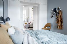 Bedroom in mustard and soft blue - via Coco Lapine Design blog