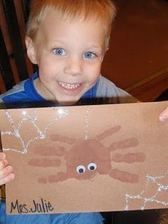 Little Miss muffet spider craft with handprints. #nurseryrhymes
