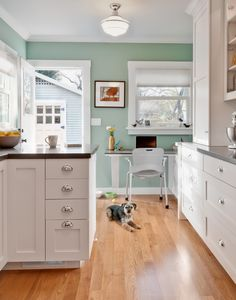 Found on House of Turquoise. Interior designer Gina Viscusi Elson worked with designer Melissa Nierman of the handcrafted cabinetry company Rutt of Los Altos to design this super-cute cottage kitchen.