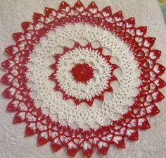 red in white lace crocheted doily