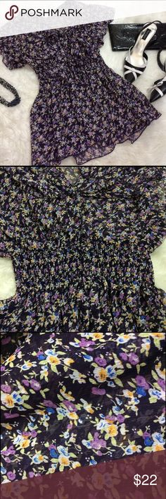 "Sheer floral purple Blouse This top will have you ready for warmers weather! Purple flowers cover this dark purple blouse. Cinched elastic waist. Buttons, ruffles.   Size M  pit to pit 15""  waist (is elastic) 10""  length 24""   good condition Sammy Tops Blouses"
