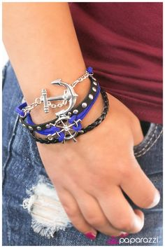 Anchors Away - Blue   Braided black leather and a strand of silver studs is complemented by blue suede in a boyfriend bracelet style. Gorgeous nautical elements in a classic silver finish add undeniable charm. Features an adjustable clasp closure  Sold as one individual bracelet.